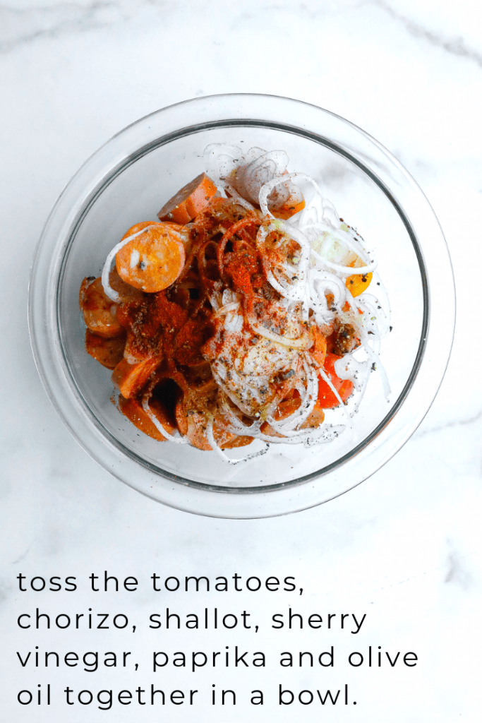a bowl of chorizo tossed with tomatoes, sherry vinegar, olive oil and shallot