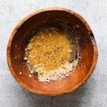 Lemon-Dijon vinaigrette in a wooden salad bowl