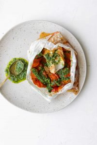 Cod cooked in parchment paper with chorizo and tomatoes