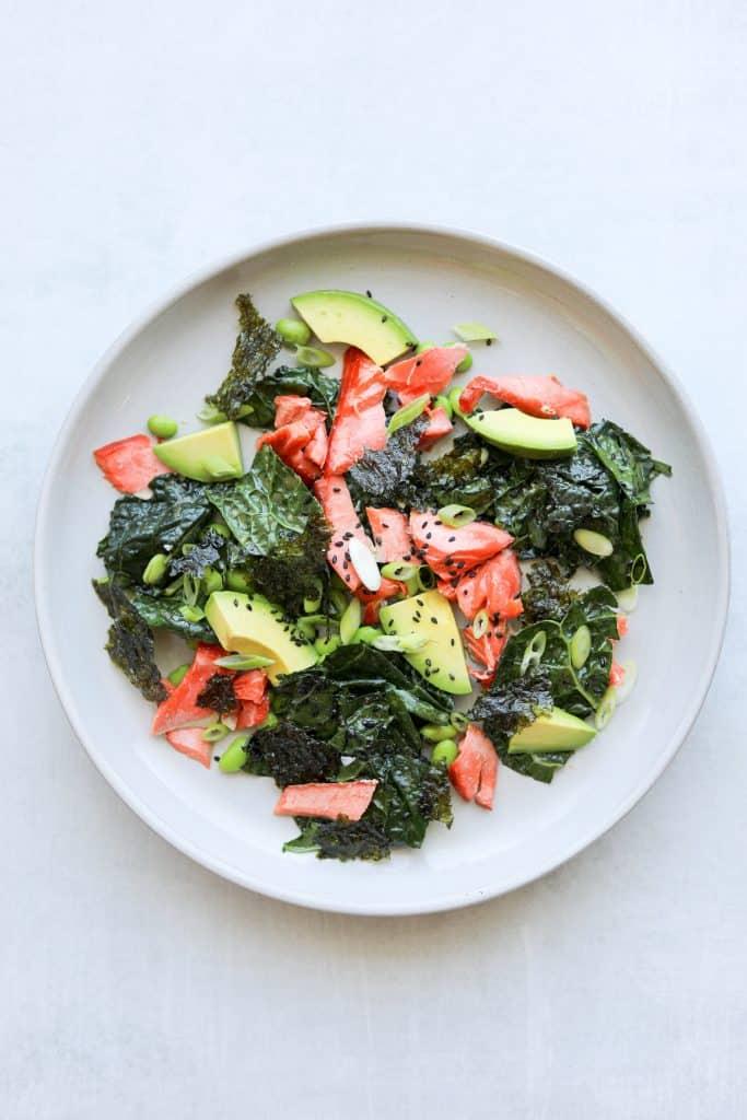 Salmon salad with kale, edamame, seaweed and avocado