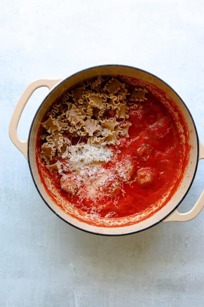 Turkey meatballs, pasta and tomato sauce in a pot