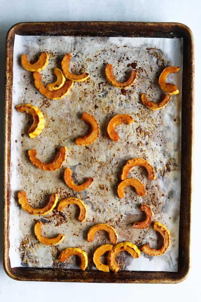 roasted delicata squash on a baking tray