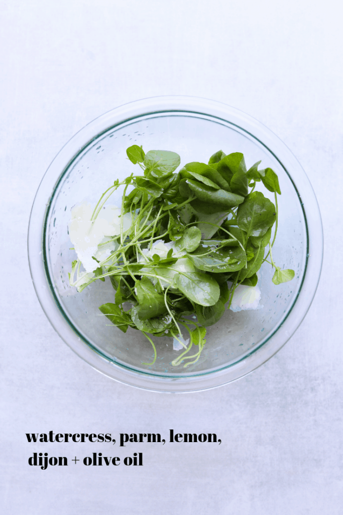 watercress salad in a glass bowl
