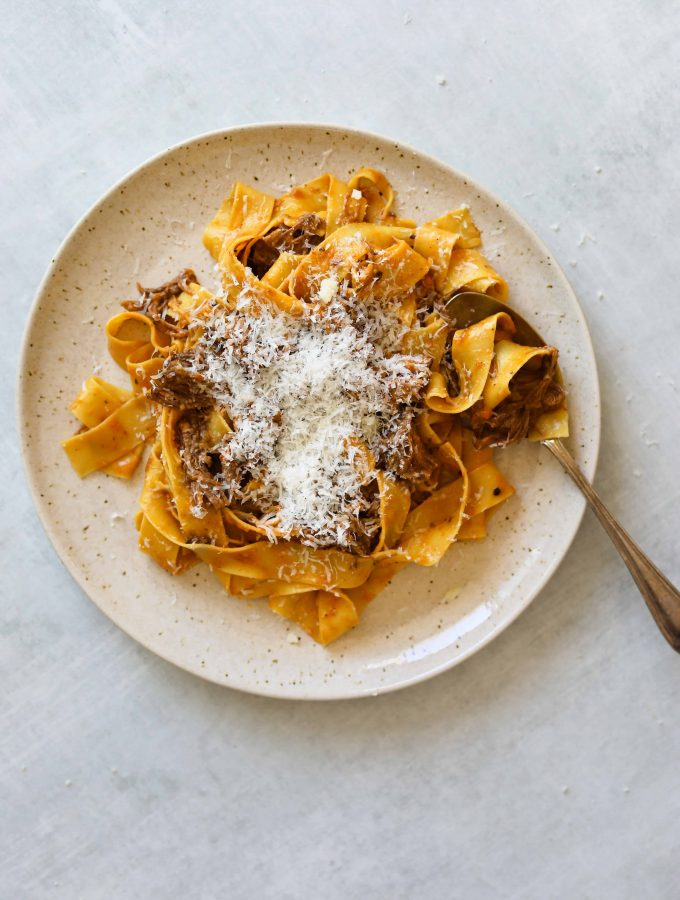 Short Rib Ragu with Pappardelle on a plate with a spoon