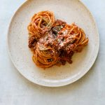 Fennel and Pork Bolognese on a Cream Colored Plate