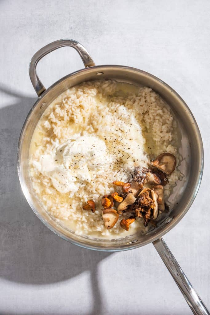 Creamy Roasted Mushroom Risotto with Truffle Oil in a pot being stirred together