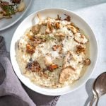 Creamy Roasted Mushroom Risotto with Truffle Oil In a bowl with a blue background