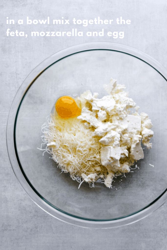 mozzarella, feta and an egg in a bowl