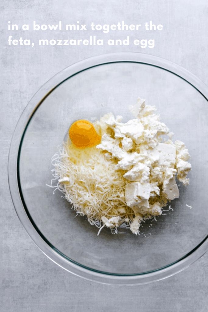 mozzarella, feta and an egg in a bowl