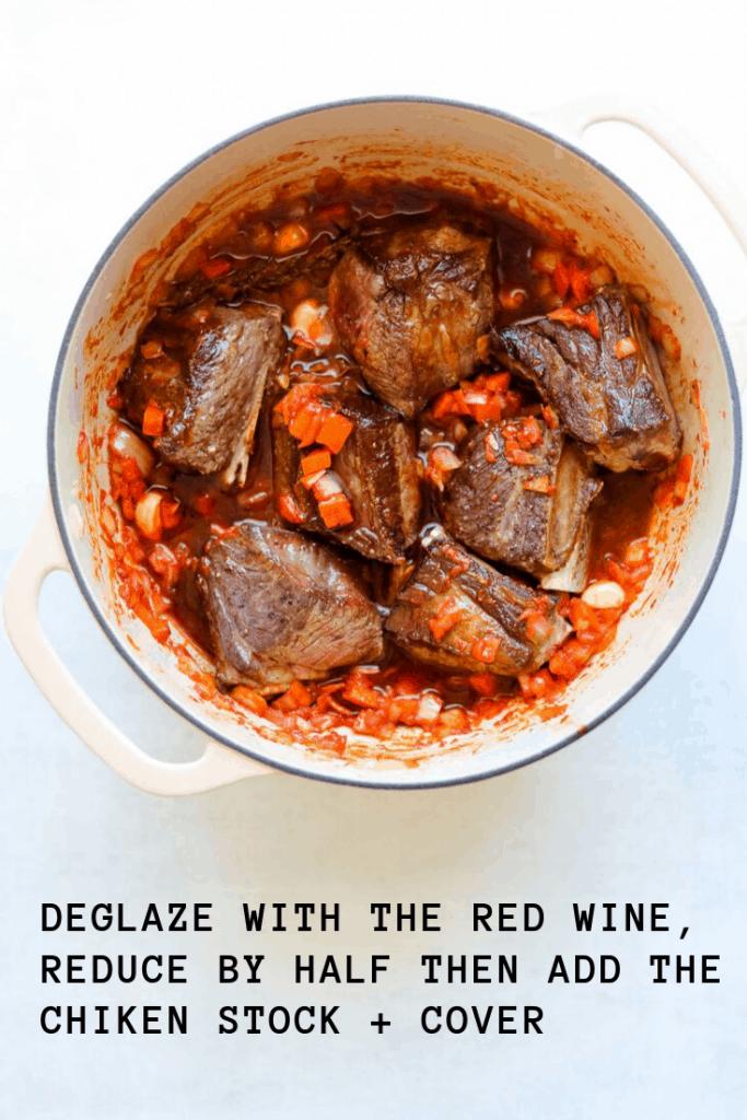 short ribs braising in red wine, chicken stock and aromatics
