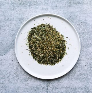 a white plate with furikake seasoning on it