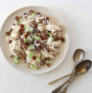 Sonoma Chicken Salad on a plate with grapes, pecans and celery