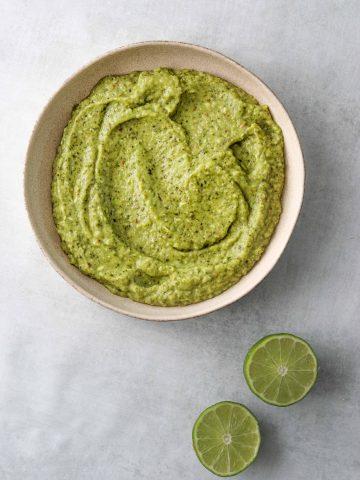 creamy avocado salsa in a white bowl