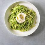 a white bowl filled with Tagliatelle with Pea Pesto and Creme Fraiche