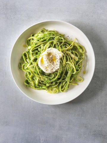 a white bowl filled with Tagliatelle with Pea Pesto and Creme Fraiche