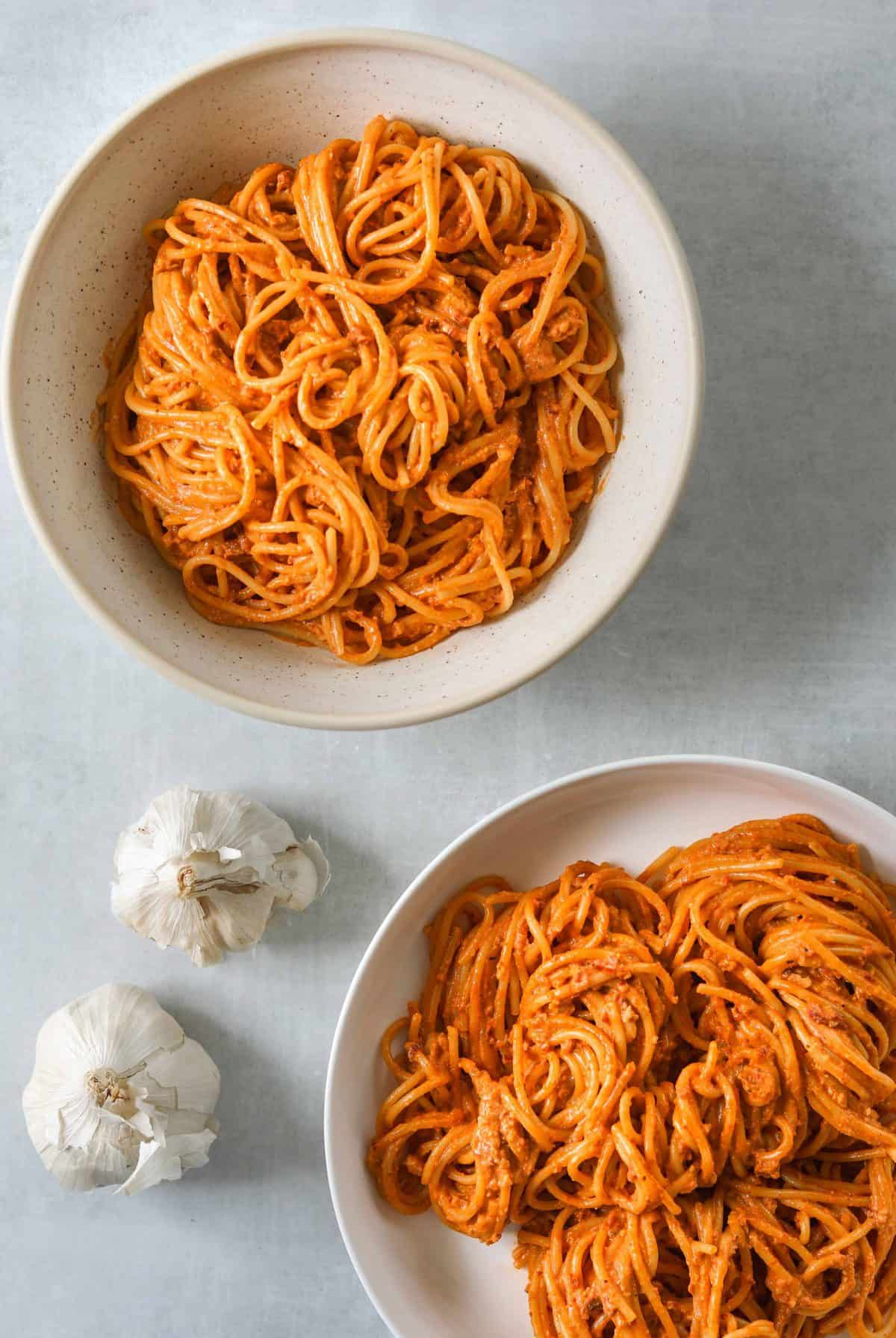 two bowls of Bucatini with Sun-Dried Tomato Pesto
