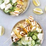 two bowls of Grilled Swordfish Kebabs with Green Goddess Yogurt with couscous, feta cheese and cucumber