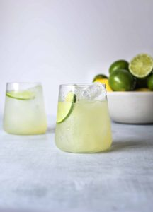 two ice cold glasses of mezcal margaritas