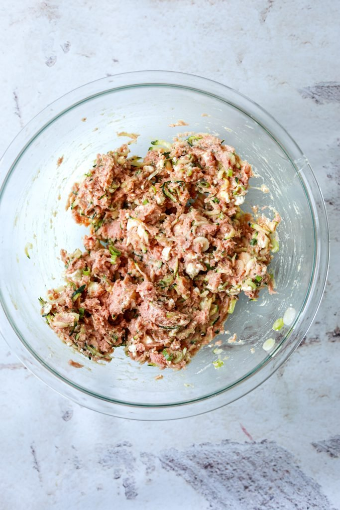 raw turkey burger mixture in a large mixing bowl