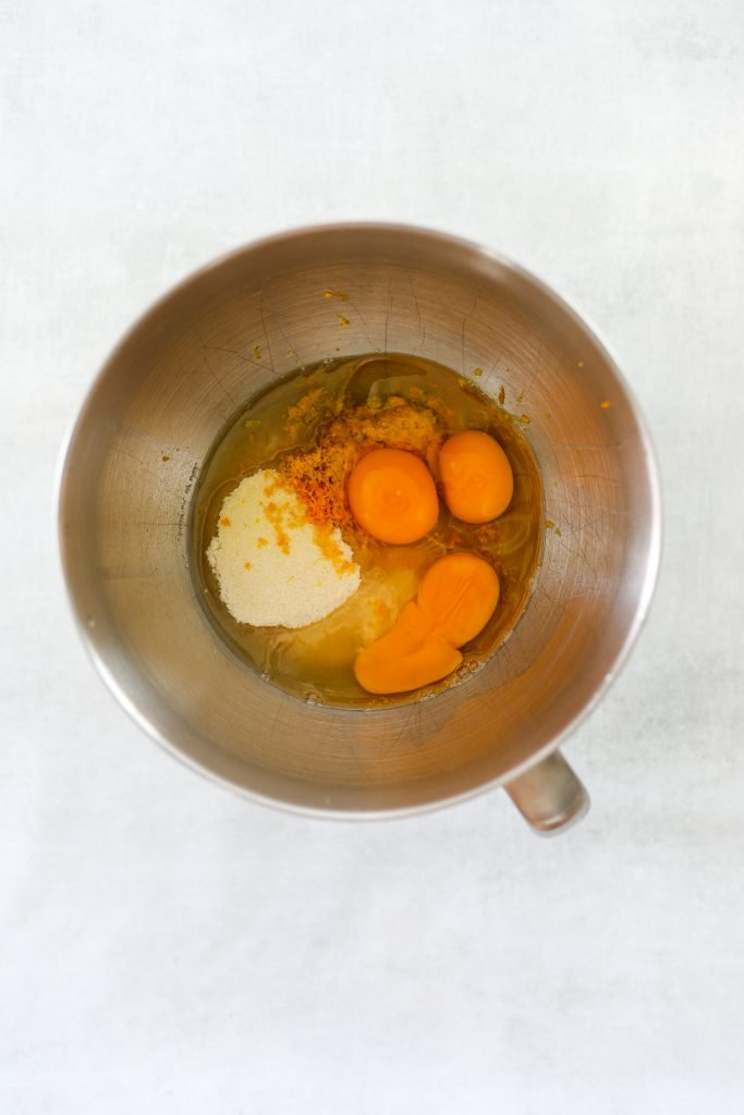 eggs, sugar and orange zest in a mixing bowl