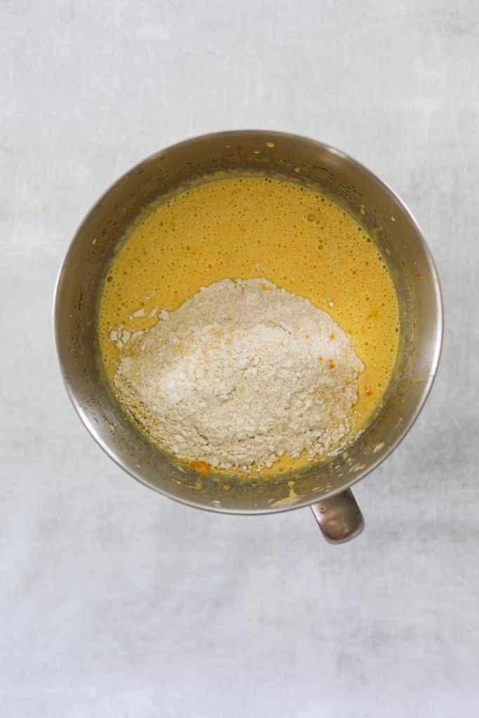 cake batter and gluten-free flour in a mixing bowl