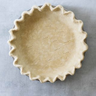 flakey pie crust dough in a pie tin