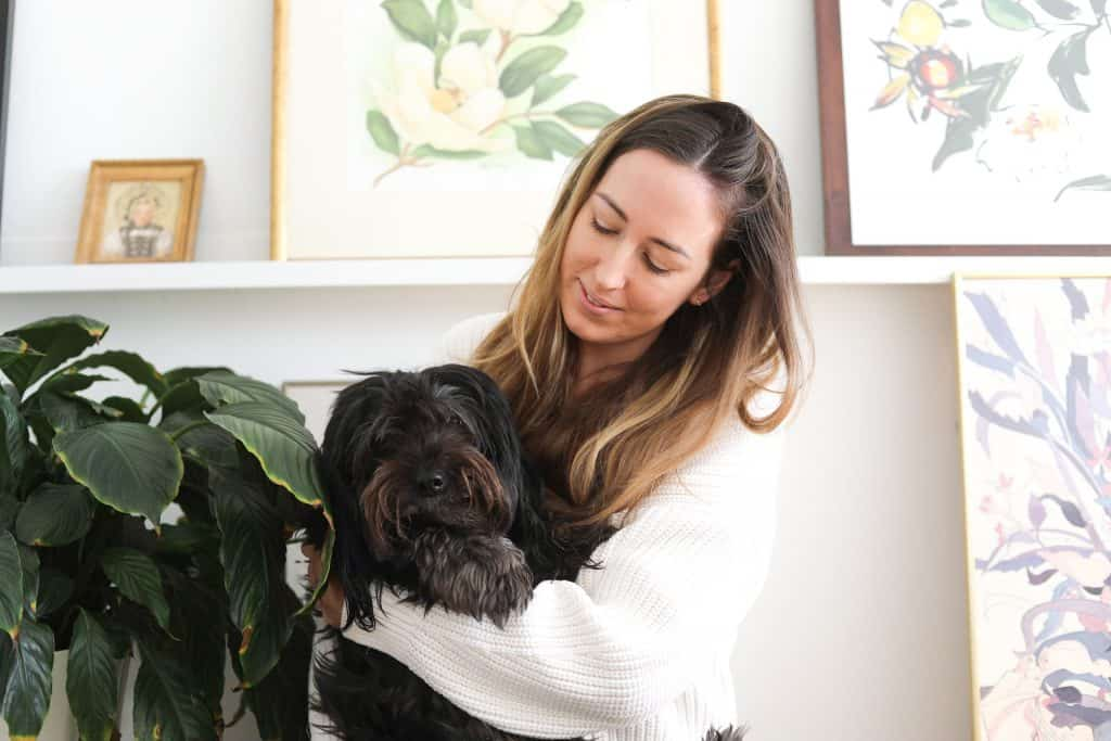 a photo of chef Leigh Anderson holding her dog Theo