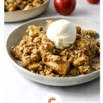 a bowl with gluten-free apple crisp and vanilla ice cream