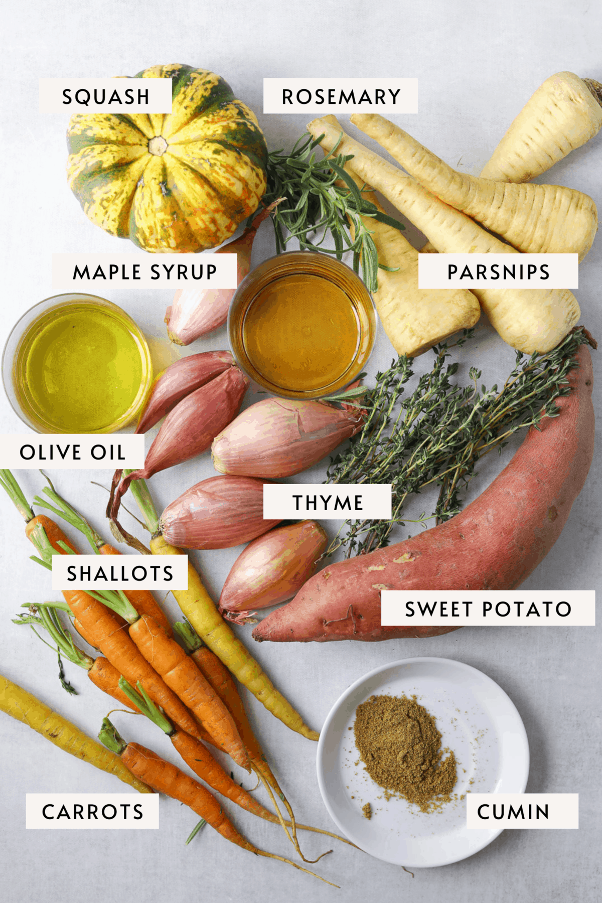 an assortment of produce; squash, parsnips, shallots, thyme, rosemary, sweet potato and carrot