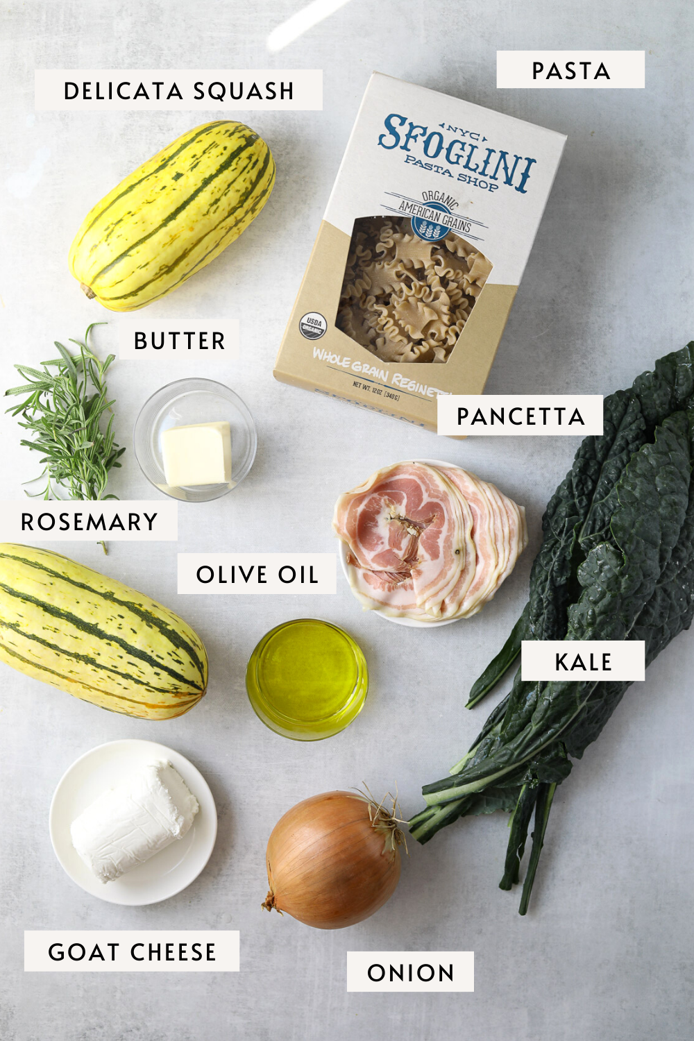 a box of pasta, two delicata squash, a bunch of kale, sliced panetta, rosemary and butter