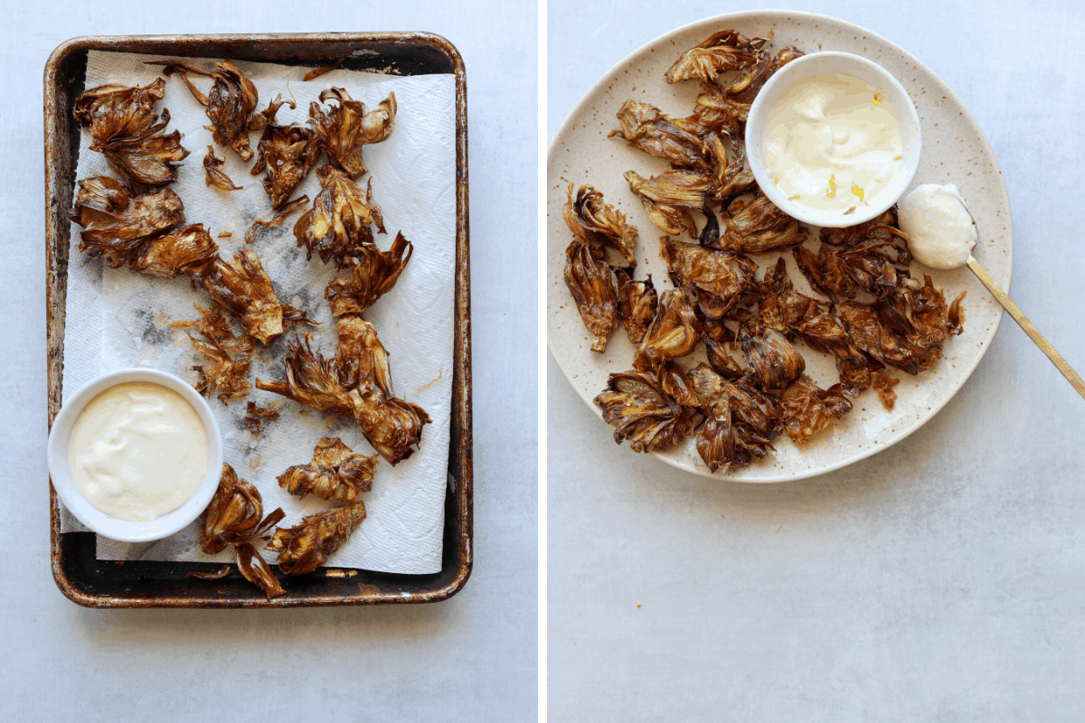 fried artichokes draining on a paper towel lined tray and a plate of fried artichokes with aioli on the side.