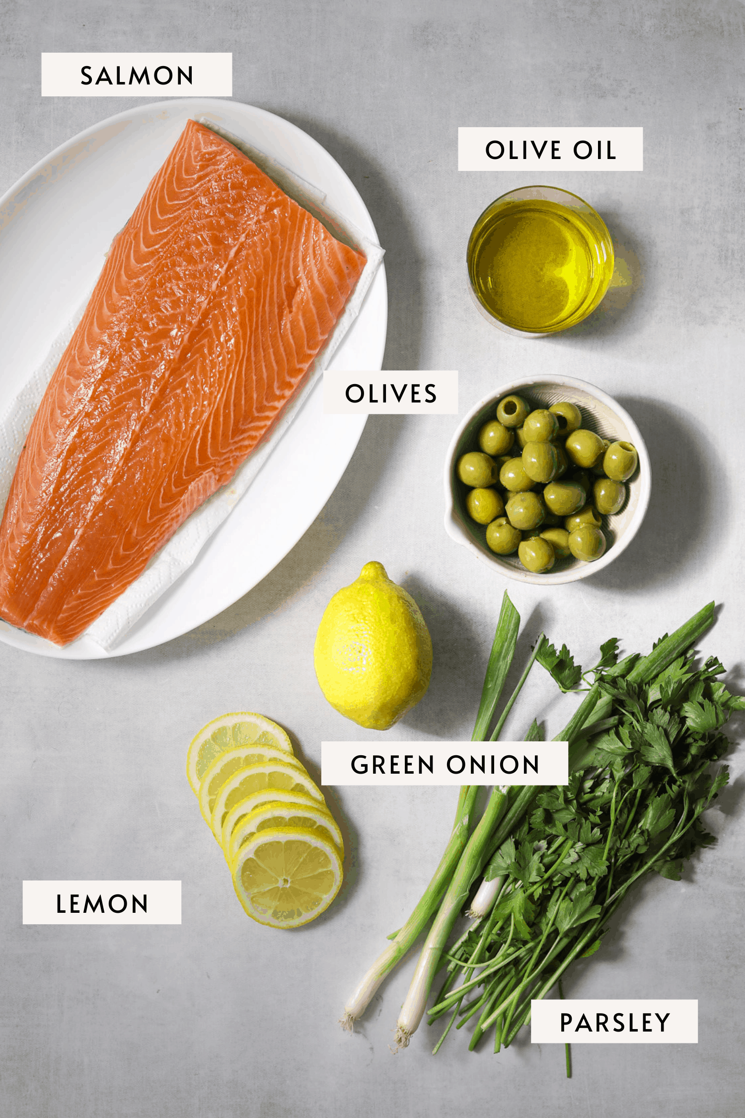 recipe ingredients: filet of salmon, fresh parsley, castelveltrano olives, lemon, green onion and olive oil