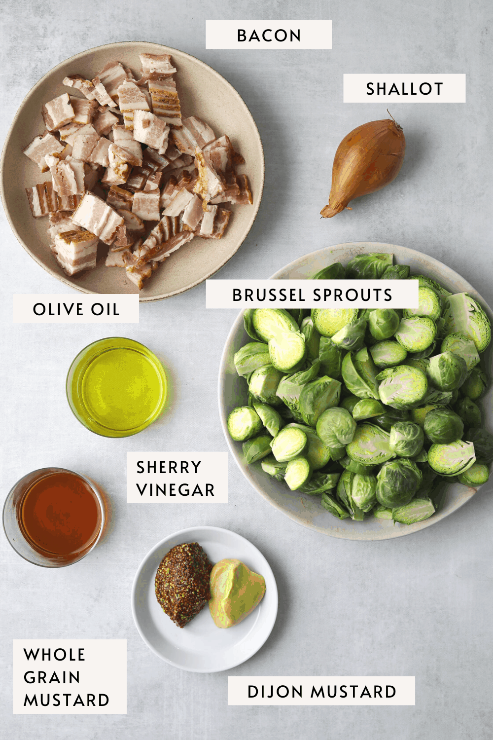 recipe ingredients: a bowl of Brussel sprouts, dijon mustard, whole grain mustard, bacon, vinegar and olive oil