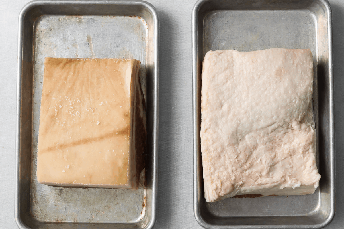 a side by side of two slabs of pork belly, one with the skin on, one with the skin off