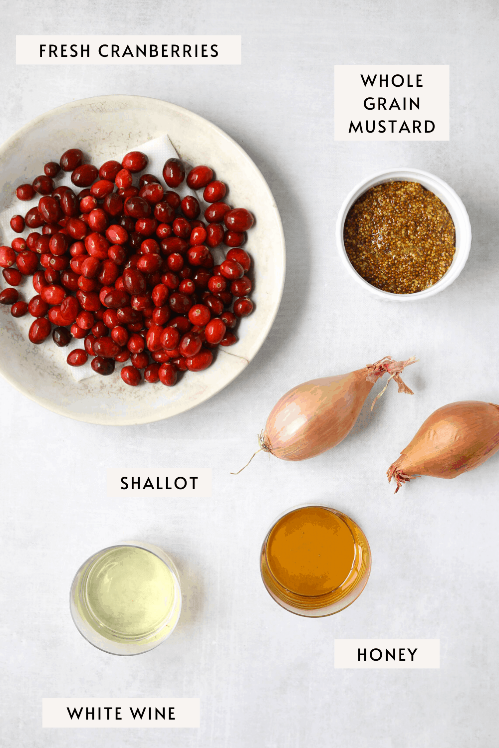 cranberry mustard ingredients; two shallots, a cup of honey, a cup of whole grain mustard a cup of white wine, fresh cranberries