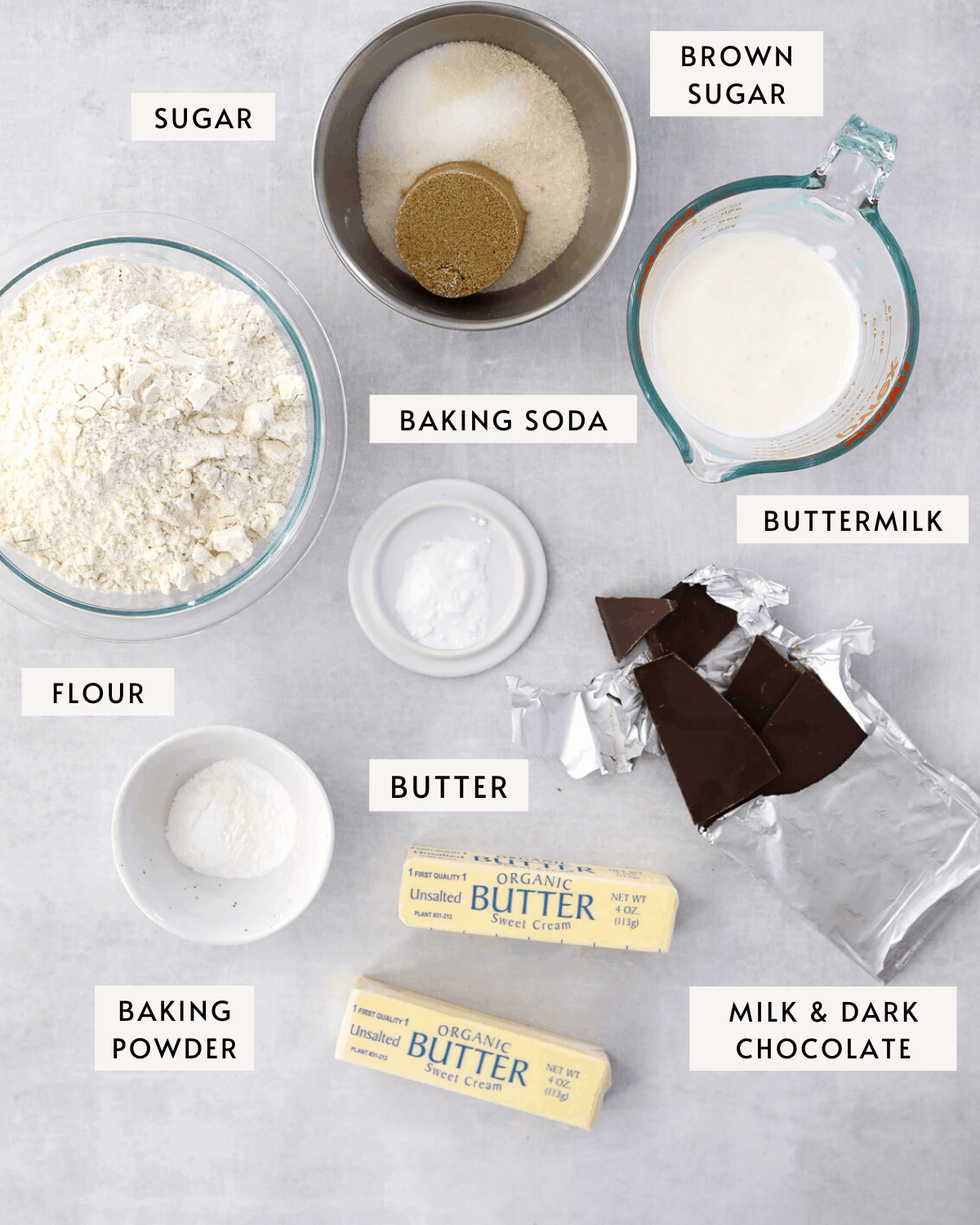recipe ingredients individually portioned, a bowl of flour, buttermilk, butter, bars of chocolate