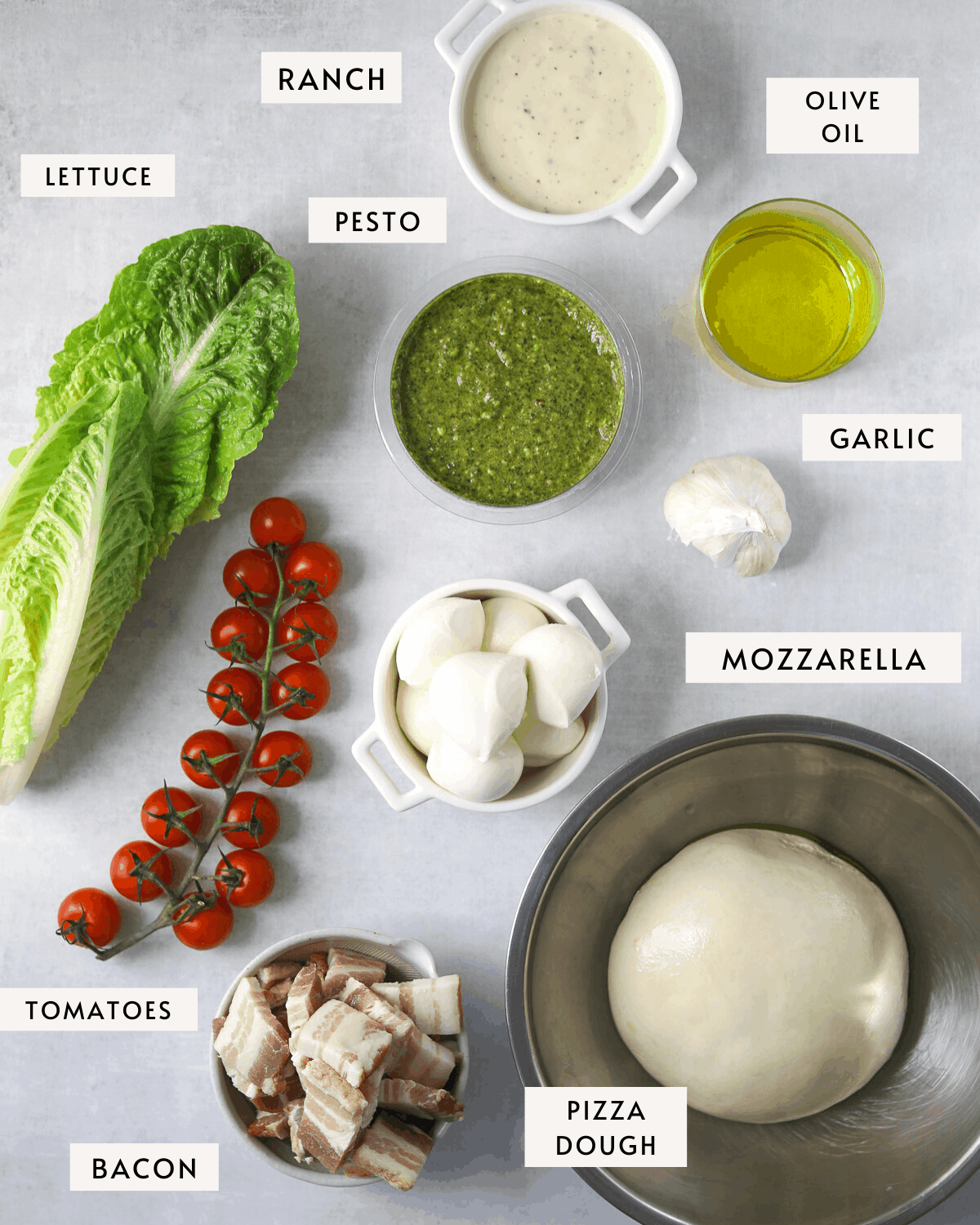 BLT Pizza ingredients, pizza dough, tomatoes, ranch dressing, basil pesto, olive oil
