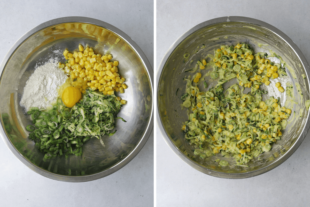 two metal mixing bowls filled with corn and zucchini fritter batter on a blue background