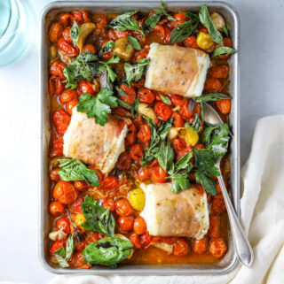 a sheet pan with Prosciutto Wrapped Halibut with Slow-Roasted Tomatoes