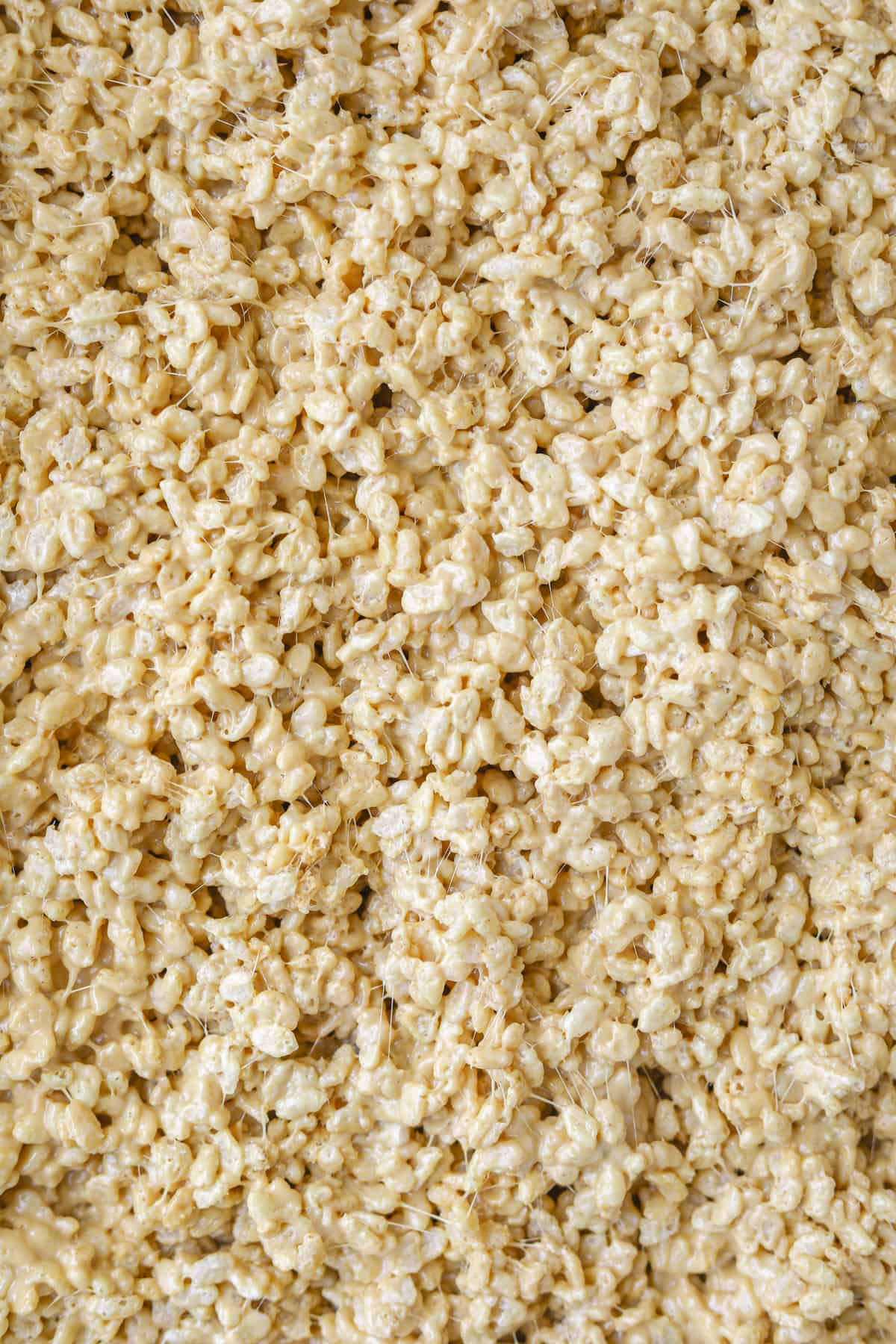 close up view of caramelized white chocolate rice crispy treats