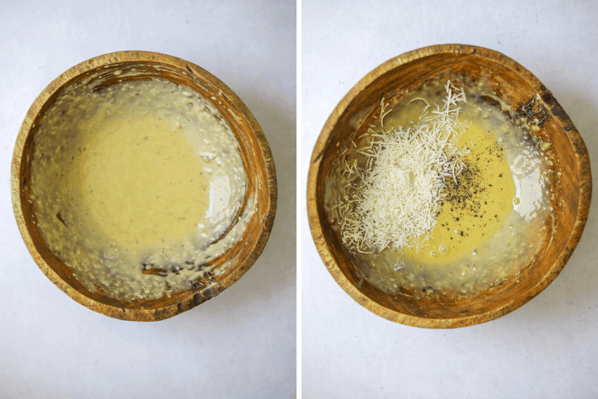 two wooden salad bowls with caesar salad dressing, grated parmesan cheese and black pepper