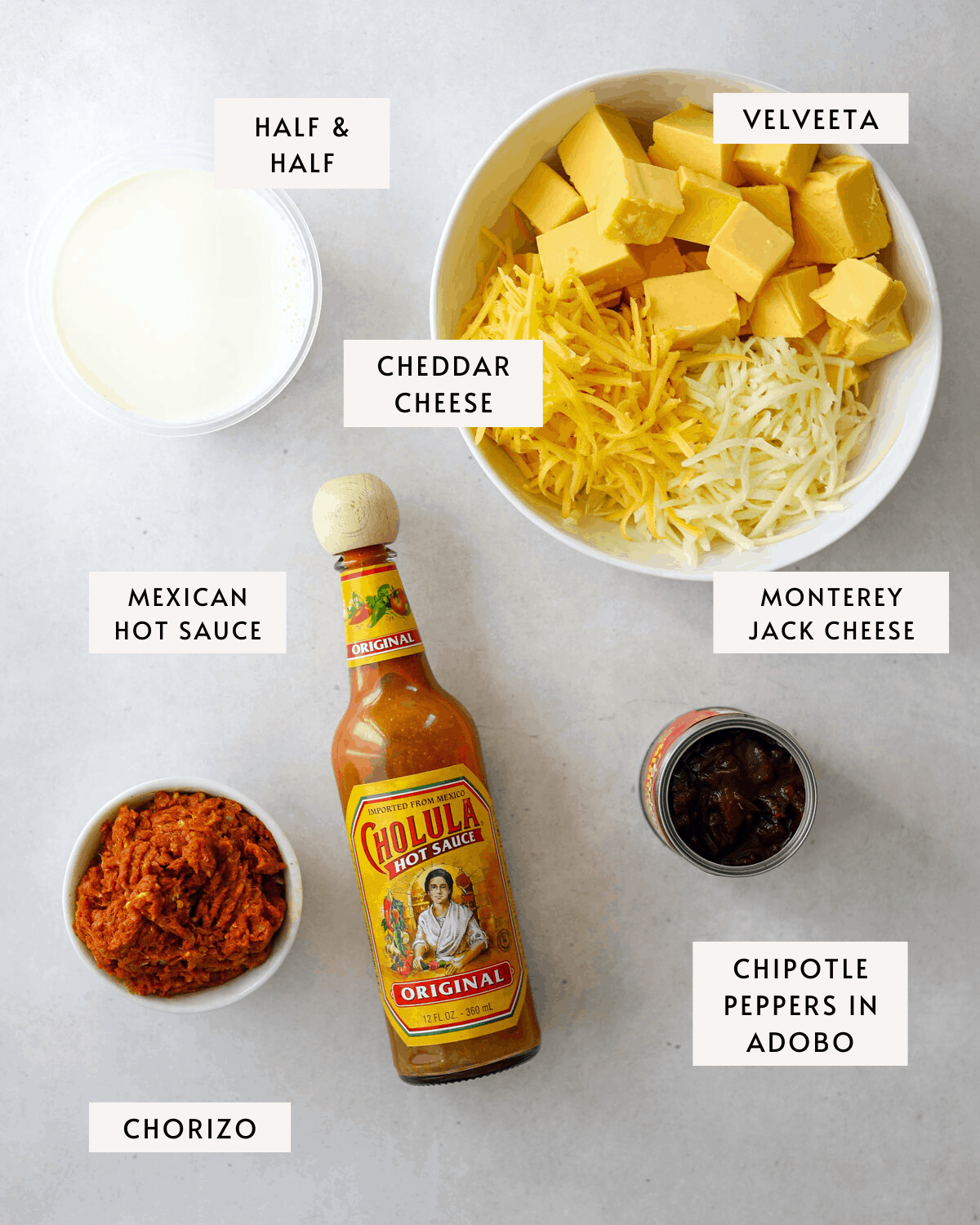 recipe ingredients: half and half, three typed of shredded cheese, hot sauce, chorizo and chipotle peppers